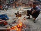 Кузнечные работы в Чжаосине, провинция Гуйчжоу, Китай